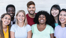 Happy Friends From Different Races And Culture Laughing In Front Of Phone Camera - Young Millennial People Having Fun Together - Multiracial Generation Concept - Main Focus On Center Girls