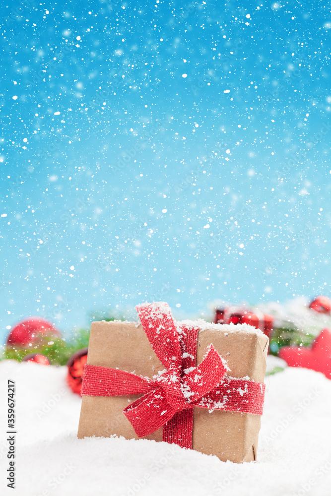 Fototapeta Christmas greeting card with decor and gift box