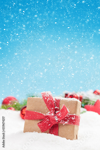 Christmas greeting card with decor and gift box