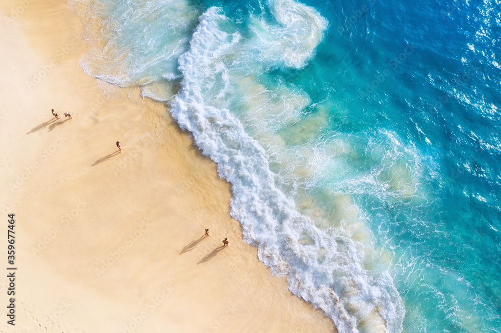 Fototapeta Beach, people and waves. Coast as a background from top view. Blue water background from drone. Summer seascape from air. Nusa Penida island, Indonesia. Travel - image
