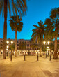 Barcelona at night, illuminated Plaza Real in in Gothic quarter of Barcelona, Catalonia, Spain. Barcelona at night or early in the morning