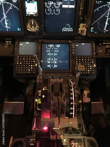 Obraz na plátne Cockpit of Boeing 737 airplane, pedestal.
