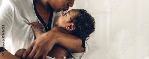 Fotografie, Obraz Portrait of enjoy happy love family african american mother playing with adorable little african american baby