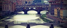 Bridges Over The Arno River That Crosses Florence With An Antiqu