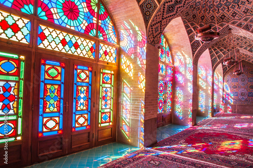 Fototapeta Famous pink mosque decorated with mosaic tiles and religious calligraphic scripts from Persian Islamic Quran, Shiraz, Iran