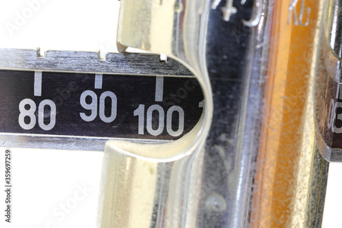 Photo Ancient bathroom scale with the number 100