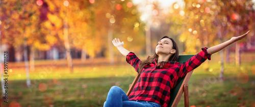 Happy Woman Enjoying Life in the Autumn Fotobehang