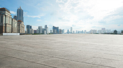 Wide empty concrete floor with cityscape view