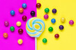 canvas print picture - Bright lollipop with decor on colorful background. Children festive composition.
