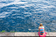 Young Woman Resting By The Lak...