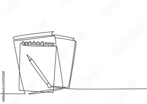 Foto Single continuous line drawing of notebook or notepad with a pencil above work desk