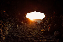 Lava Cave And Warm Sunset Ligh...