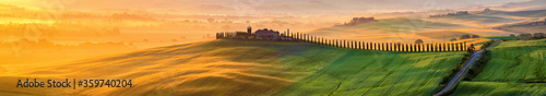 Tuscany landscape at sunrise. Typical for the region tuscan farm house, hills, vineyard. Italy - 359740204