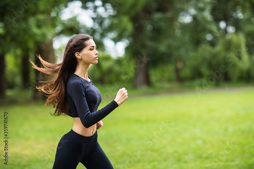 Fotografie, Obraz The girl is engaged in morning jogging in the fresh air
