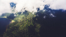 Aerial Photo From Airplane Cockpit Of A Beautiful Nature Scenery With White Clouds Over Green, Tropical Island Near Indian Ocean In Bali In Summer Season. View From Flying Plane On An Asian Landscape