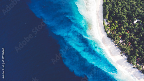 Obraz na plátně Top view aerial drone photo of stunning colored sea beach with crystalline water