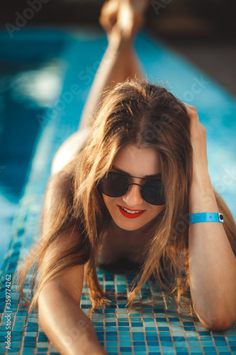 sexy young model at the sea by the pool