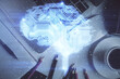 Multi exposure of brain sketch hologram over topview work table background with computer. Concept of big data.