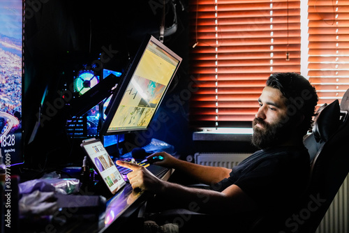 bearded man gamer on multiple monitors design render working on high end compute Canvas Print
