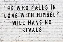 White Brick Wall With Painted Black Inscription Of Wise Quote