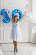 a red-haired girl in a blue dress. birthday 30 years confetti explosion