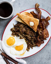 Fried Eggs, Onion And Bacon Wi...