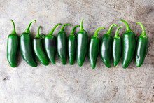Row Of Jalopeno Chilli Peppers