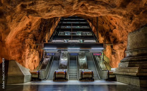 Stockholm, Sweden - August 27, 2017:  underground metro or tunnelbana station Radhuset or Court House with stone cave like wall designs