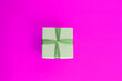 canvas print picture -    green gift box on a pink background, minimalism concept
