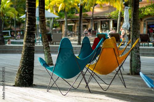 Obraz na płótnie Butterfly chairs on wooden deck