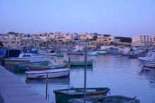 Multi-colored Fishing Boats Re...