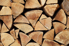 Hardwood Firewood Split Logs Stacked Quarters In A Pile, An End View.