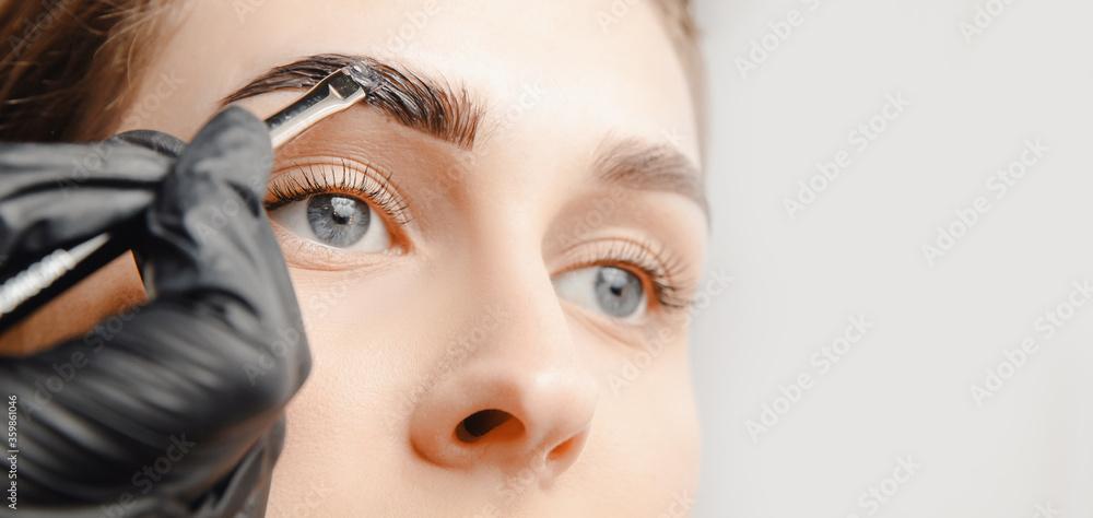 Fototapeta Eyebrow tint, master correction of brow hair women