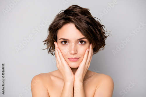 Foto Portrait of magnificent elegant girl touch face hands look in mirror enjoy new s