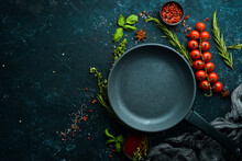 Culinary Banner. Frying Pan With Vegetables On A Black Stone Background. Top View. Rustic Style.