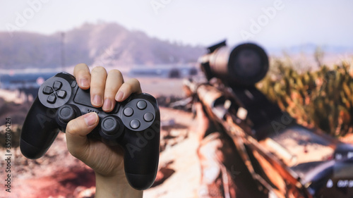 Man hand holding joystick while playing the game. Wallpaper Mural