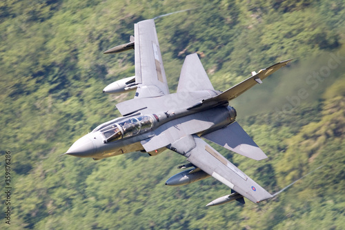 Fototapeta RAF (Royal Air Force) Panavia Tornado GR4 Fighter Bomber and reconnaissance jet flying low level in the UK, Cumbria, Wales and Scotland