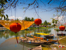 HOIAN, VIETNAM, SEPTEMBER, 04 2017: Traditional Boats In Front Of Ancient Architecture With Red Lanterns In Hoi An, Vietnam. Hoi An Is The World's Cultural Heritage Site, Famous For Mixed Cultures