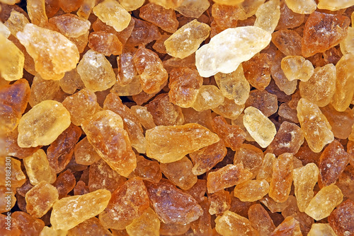 Photo close up brown rock sugar crystal for background texture
