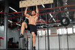 Man climbing pegboard gym athlete training arm strength stamina alpinism indoor. Ideal body with perfect abs naked torso
