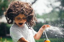 Fun Child Plays With Water In ...