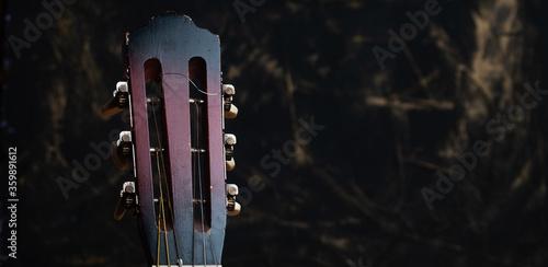 Obraz na plátne Acoustic guitar close up on a black background,