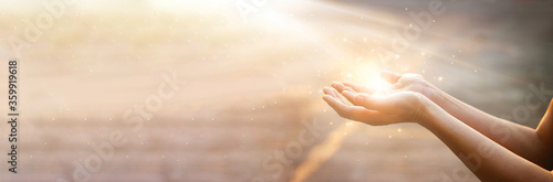 Woman hands praying for blessing from god on sunset background Canvas