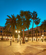 Barcelona at night, panoramic image of illuminated Plaza Real in in Gothic quarter of Barcelona, Catalonia, Spain