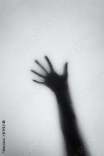 Fototapety, obrazy: Concept of a frightened woman behind sheet with backlighting in monochrome