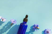 Blue Glass Bottle With Serum A...