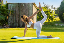 Woman Doing Yoga On A Mat On L...