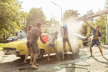 Group Of Friends Washing Yello...