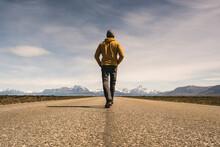 Man Walking On A Road In Remot...
