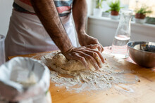 Crop View Of Man Kneading Dough